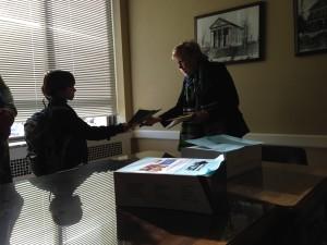 Handing letters written in class to the Senator.